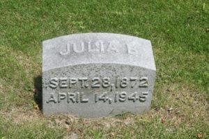 A close-up color photograph of Julia B. Mayer's gravestone. The inscription says Julia B / Sept 28, 1872 / April 14, 1945.